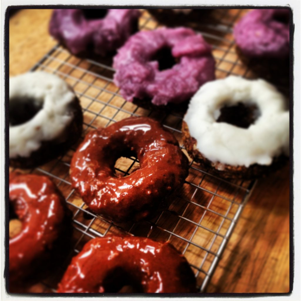 raw iced donuts with 3 flavours - berry, cacao and coconut